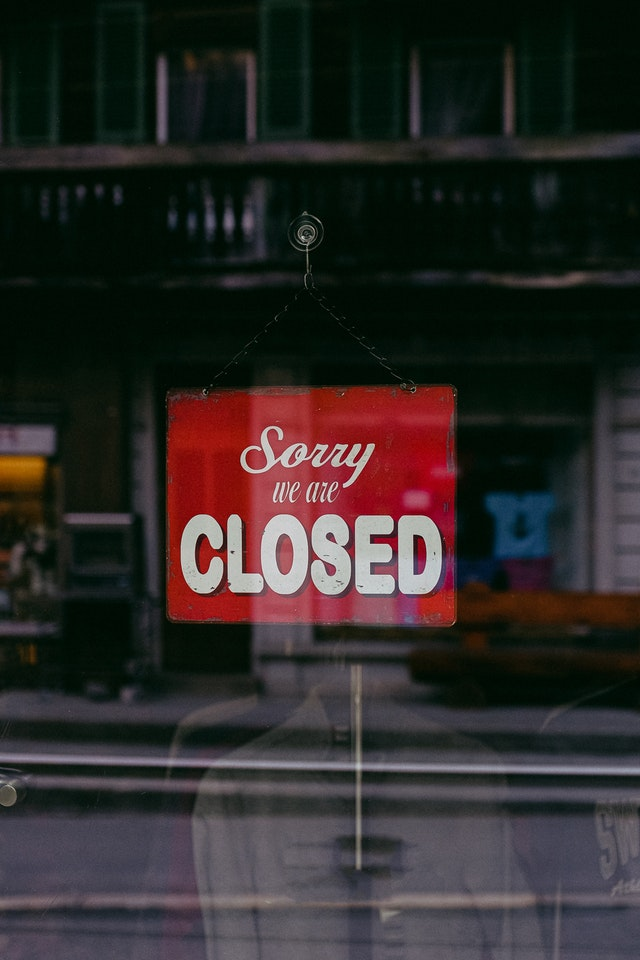 Sign reading 'sorry, we're closed'