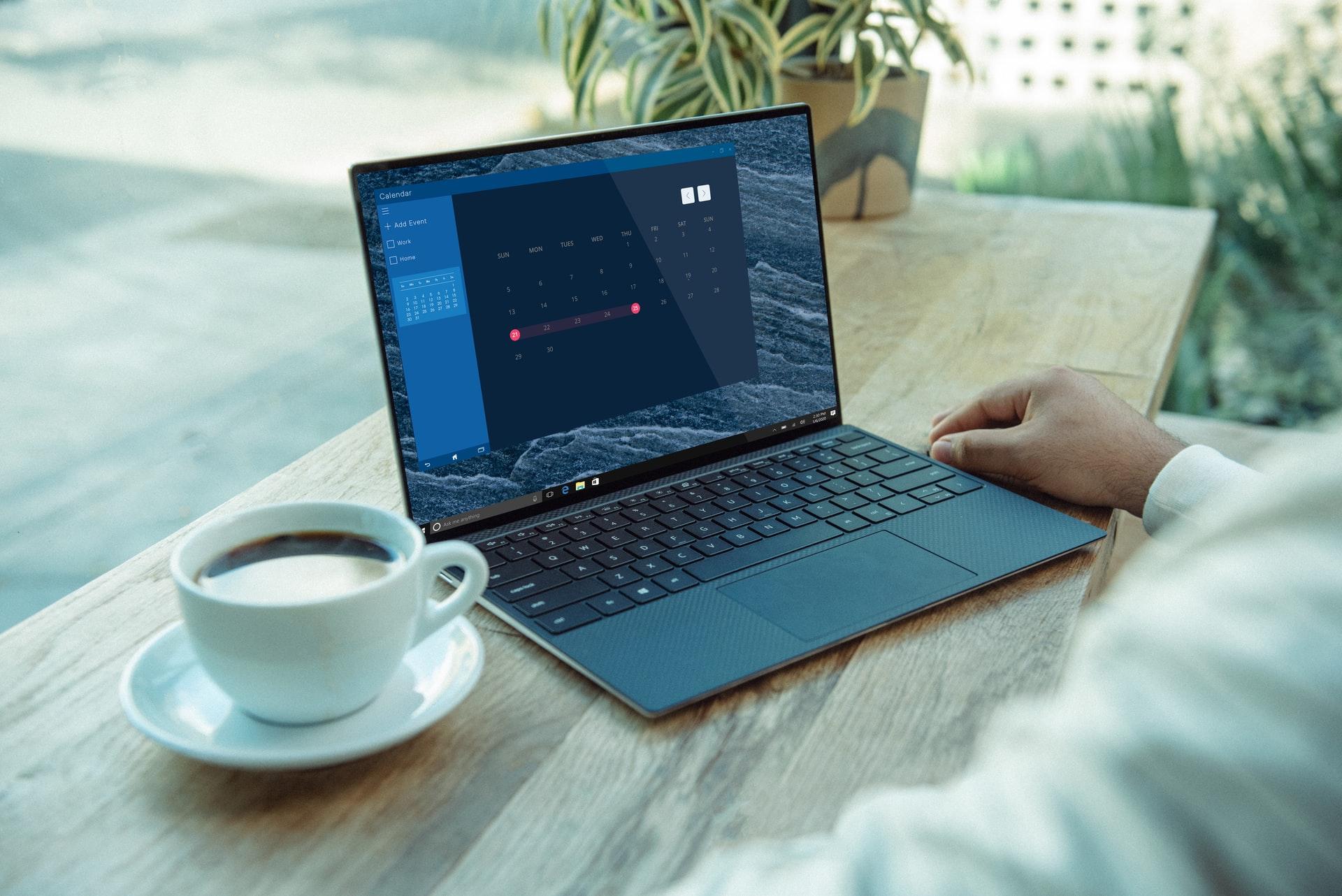 Remote working laptop desk coffee / unsplash