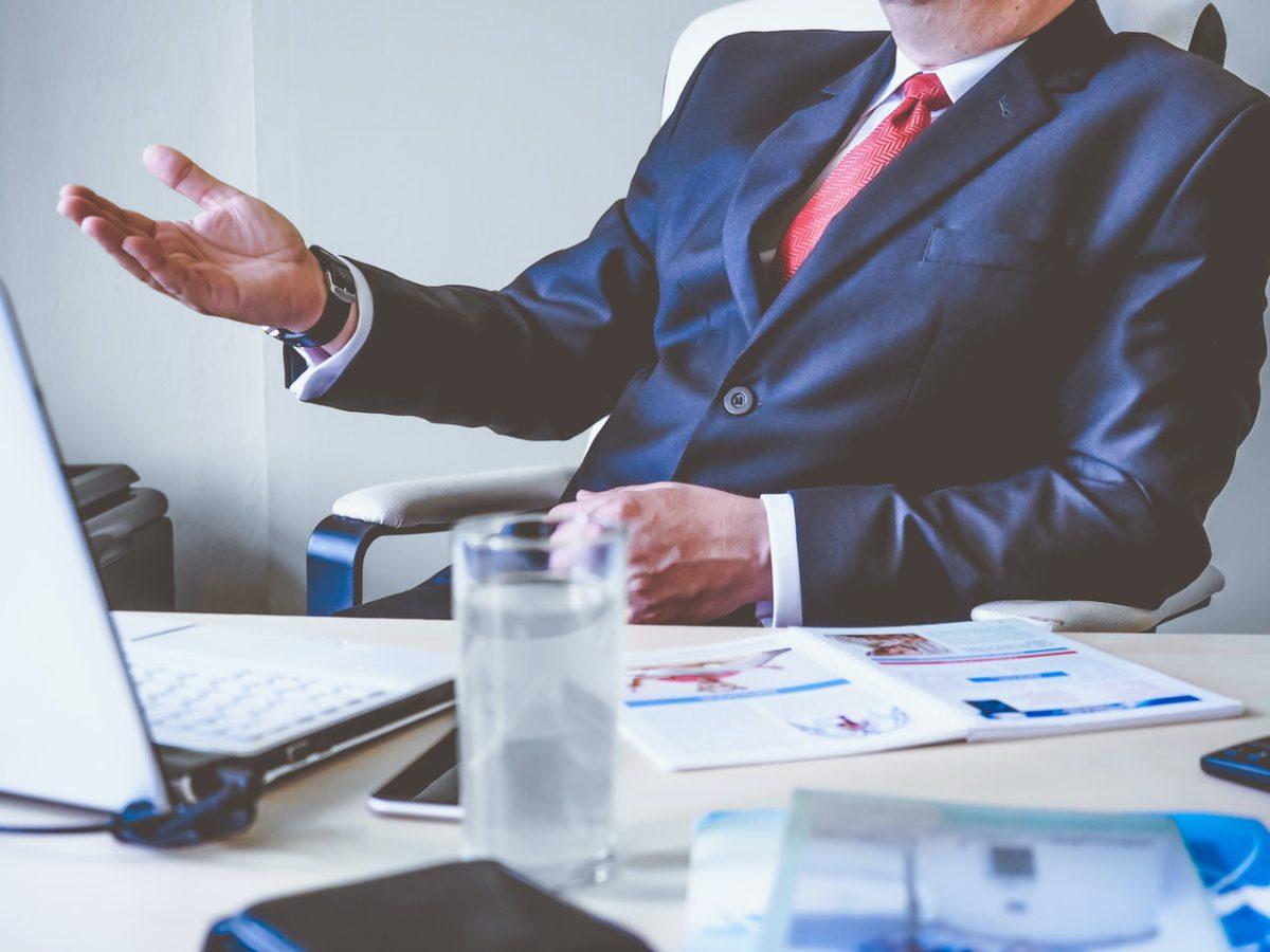 financial services professional desk suit man pexels